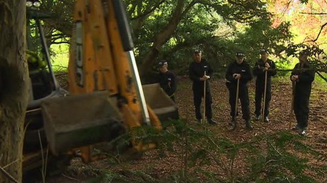 Police officers and a digger