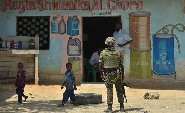 AU soldier outside a shop