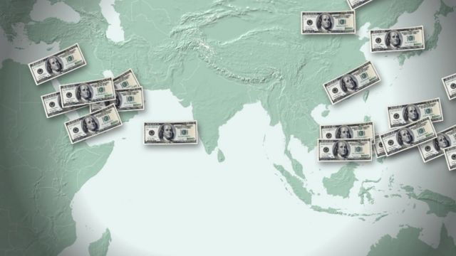 Graphic of dollar notes superimposed on map of Asia