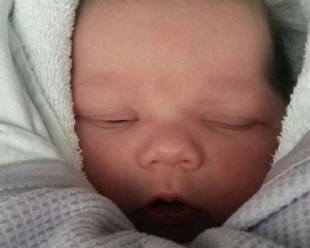 Stockport baby death: Man charged with murder
