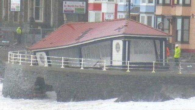 A seaside shelter falling into the sea
