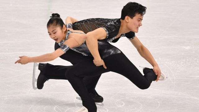 Kim Ju Sik and Ryom Tae Ok compete in the pair skating short program of the figure skating event