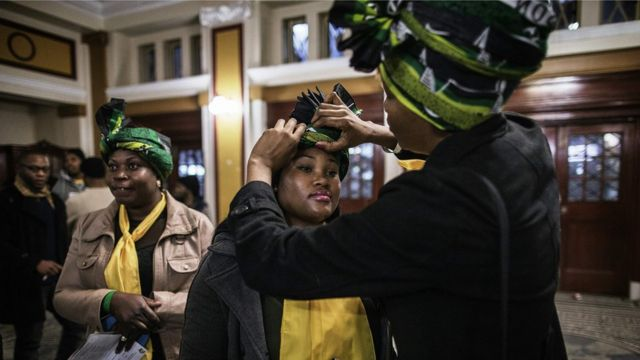 South African governing party African National Congress Women League members adjust their party attires during a election campaign event at the Johannesburg Town Hall in Johannesburg, South Africa - Wednesday 27 July 2016