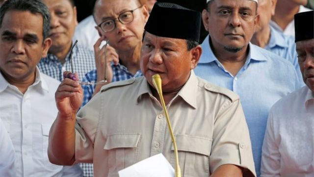 Indonesian presidential candidate Prabowo Subianto speaks to the media after polls closed in Jakarta, Indonesia April 17, 201