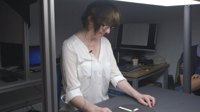 Rhian Lewis looks at a clock face with her 'bionic' eye