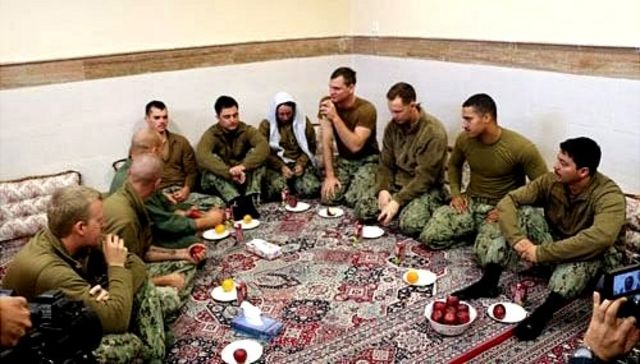 A handout picture made available by the official website of Iranian Revolutionary Guard Corps shows captured US military personnel at an undisclosed location in Iran