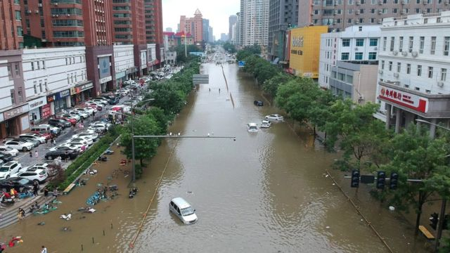 An aerial view shows a flooded road section following heavy rainfall in Zhengzhou