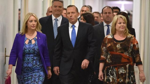 Australian Prime Minister Tony Abbott (C) walks though Parliament House in Canberra after he was dramatically ousted in a snap party vote forced by challenger Malcolm Turnbull on September 14, 2015