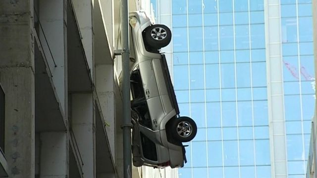 Car dangling from car park