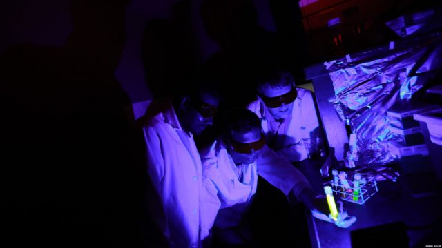 Dr. Ajith Karunarathne, Dr. John Payton and graduate student Kasun Ratnayake are examining reactions between blue light and retinal in a light proof laboratory at the University of Toledo