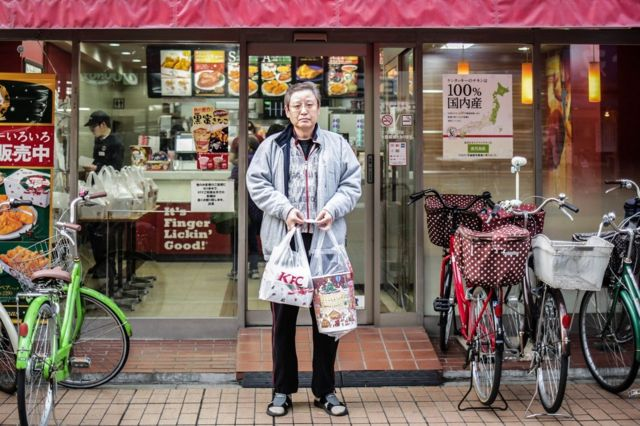 Kosei, 54 years old bought KFC for his family on December 24, 2015 in Tokyo, Japan. Some of the popular ways to spend the Japanese Christmas Eve are, spending the evening with their romantic partner, eating cakes with their family, and eating KFC for dinner. According to KFC, in 2014, approx. 43.6 million USD, nearly 4.7% of annual sales were made on December 23,24, and 25.