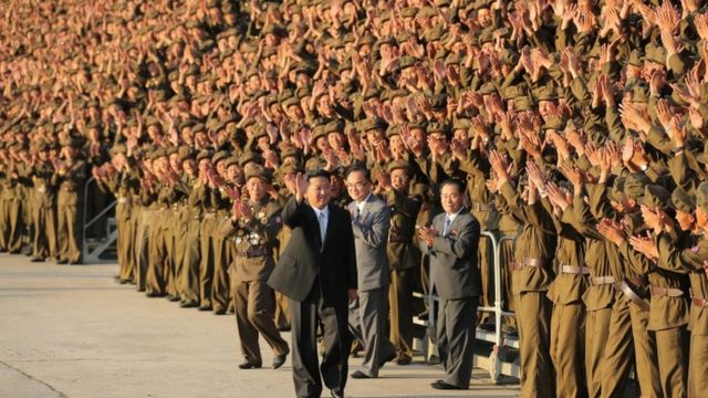 """A photo released by the official North Korean Central News Agency (KCNA) on 10 September 2021 shows North Korean leader Kim Jong-un (front C) waving during a photo session with paramilitary and public security forces on the 73rd founding anniversary of the Democratic People""""s Republic of Korea in Pyongyang, North Korea"""