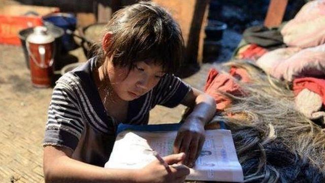 中国高调庆祝脱贫成绩,称9899万农村贫困人口全部摆脱了贫困。(photo:BBC)