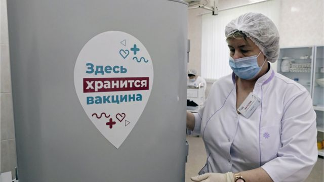 A nurse stands by a refrigerator storing the Gam-COVID-Vak (Sputnik V) vaccines at Moscow's outpatient clinic No 121