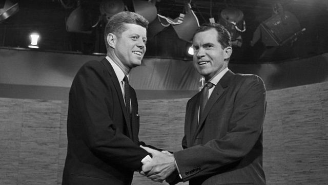 Presidential candidates John F. Kennedy and Richard Nixon shake hands after their televised debate of October 7, 1960.
