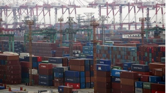 Containers are seen at a port of Shanghai Free Trade Zone, in this February 11, 2014 file photo.