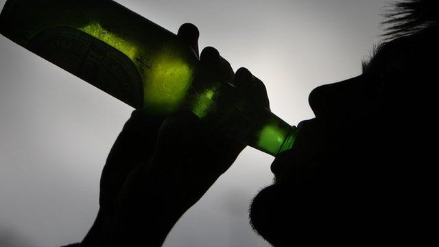 Man drinking beer from a bottle