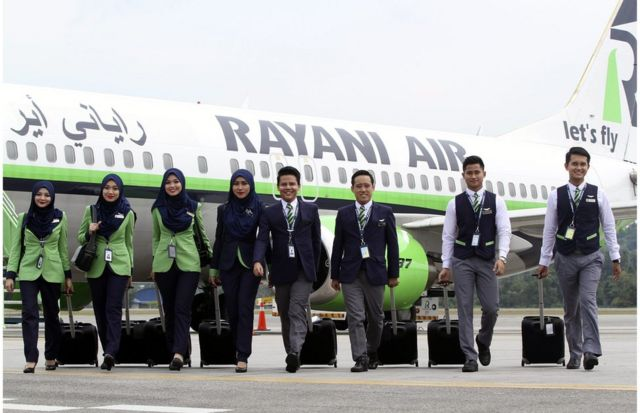 A picture made available on 21 December 2015 shows Rayani Air the Malaysia's first Islamic-compliant airline cabin crew posing for a photograph in front of a Boeing 737-400 at Kuala Lumpur International Airport 2, in Sepang, Malaysia, 20 December 2015