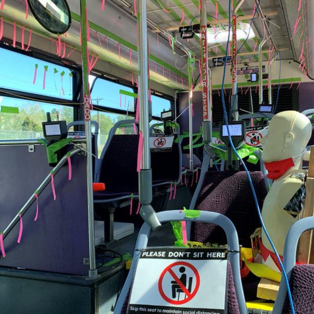 Experiment on a bus with sensors and manikin to measure aerosol dispersion with open windows