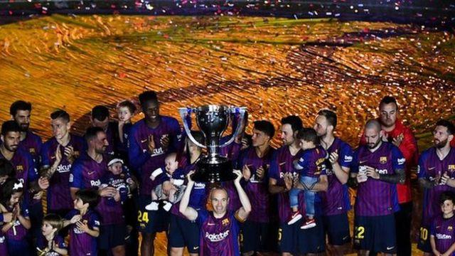 Andres Iniesta lifts the La Liga trophy