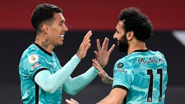 Liverpool's Roberto Firmino and Mo Salah celebrate against Manchester United