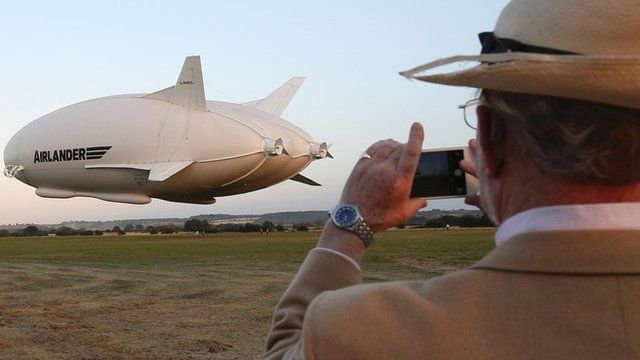 A spectator looks on as the Airlander takes off
