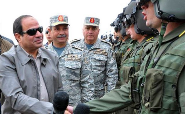 Egypt's President Sisi (L) meeting pilots working at military base near the border with Libya - 18 February 2015