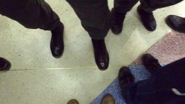 Police boots surround reporter Vladimir Hernandez