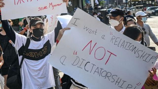 """Protest sign reading """"I want a relationship not a dictatorship"""""""