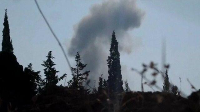 Smoke rises over Aleppo