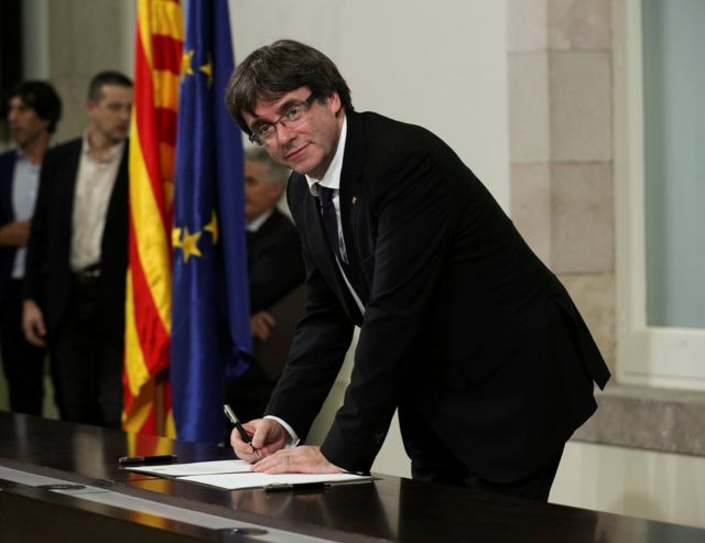 Catalan President Carles Puigdemont signs a declaration of independence at the Catalan regional parliament in Barcelona, Spain, October 10, 2017. REUTERS/Albert Gea TPX IMAGES OF THE DAY