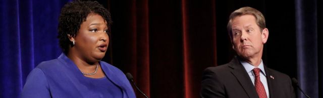 Democratic gubernatorial candidate for Georgia Stacey Abrams speaks as Republican candidate Brian Kemp looks on during a debate in Atlanta