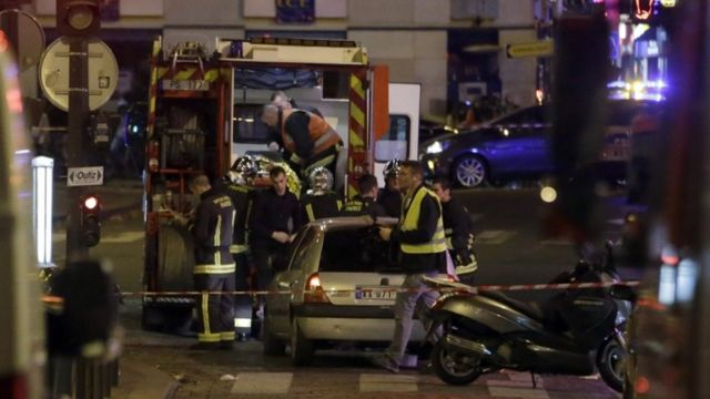 Ambulance workers are seen at the scene in the 10th arrondissement of the French capital Paris
