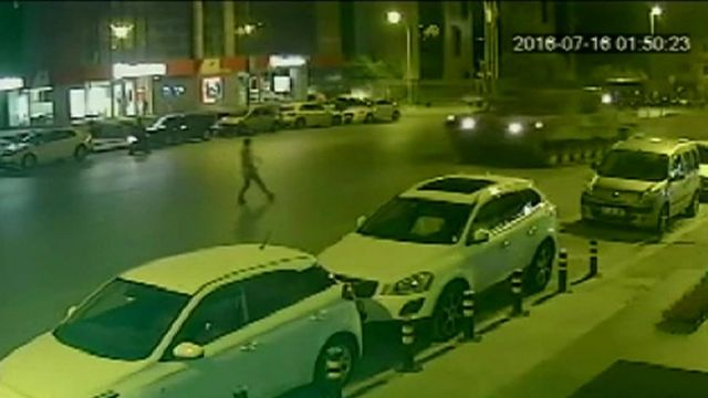 man in road as tank approaches