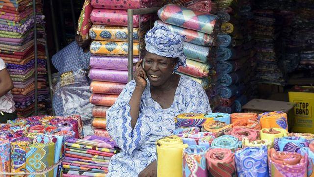 Market woman wey dey sell ankara