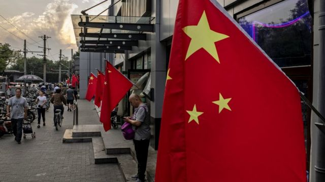Chinese flags outside a row of shops