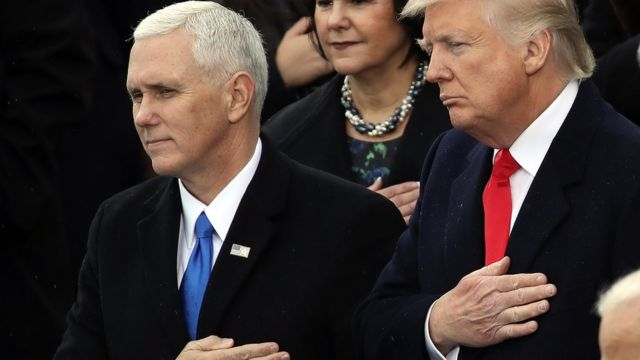 US Vice-President Mike Pence and President Donald Trump during the US national anthem