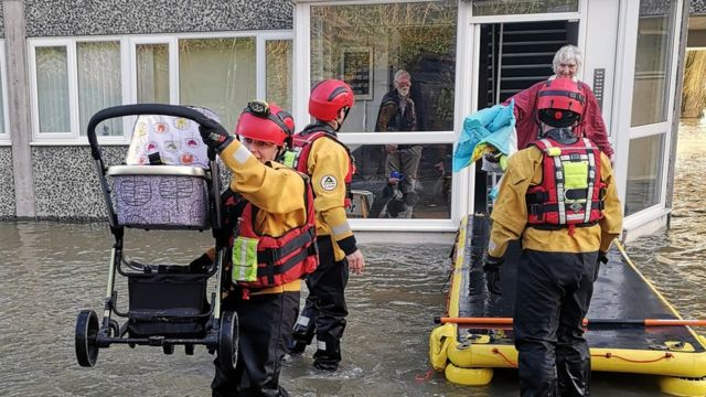 Firefighters rescuing families