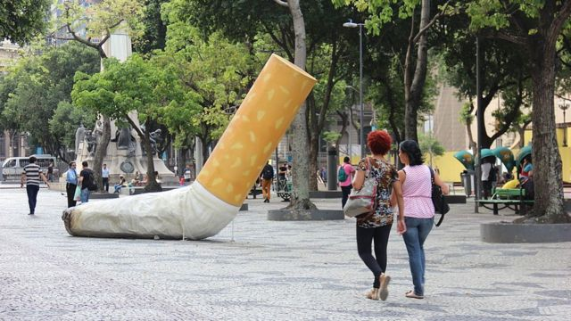 A street in Rio with a giant cigarette thrown away