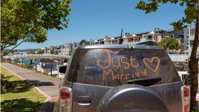 South Africa, Just married sign with a heart painted on the rear window of a car.