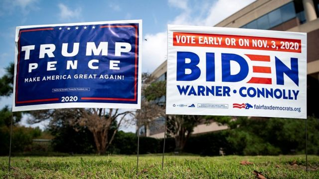Yard signs supporting U.S. President Donald Trump and Democratic U.S. presidential nominee and former Vice President Joe Biden are seen outside of an early voting site at the Fairfax County Government Center in Fairfax, Virginia, U.S., September 18, 2020