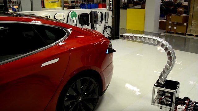 Tesla reveals robotic snake car charger