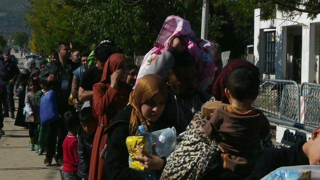 Migrants queue in Serbia