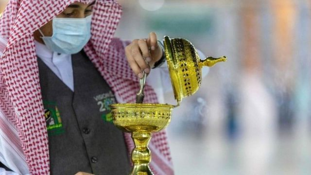 A handout picture provided by the Saudi ministry of media shows a member of the hajj staff burning incense at the Grand Mosque in the holy city of Mecca on 26 July 2020