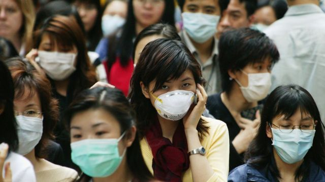People in Hong Kong wear surgical masks to try to reduce the chance of infection from SARS