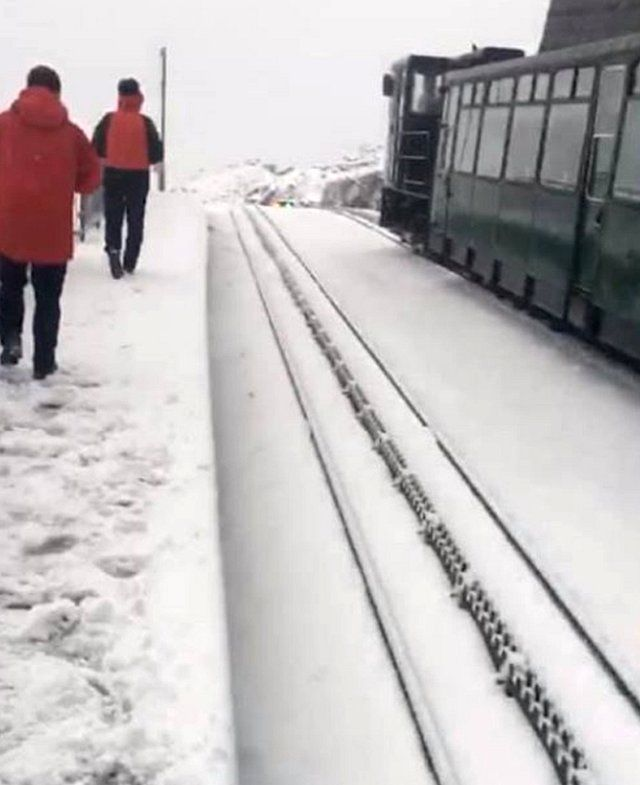 Snow at the summit of Snowdon was causing disruption to the mountain railway