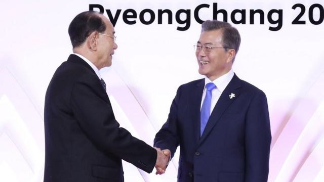 North Korea's Kim Yong Nam and South Korean president Moon Jae-in shake hands