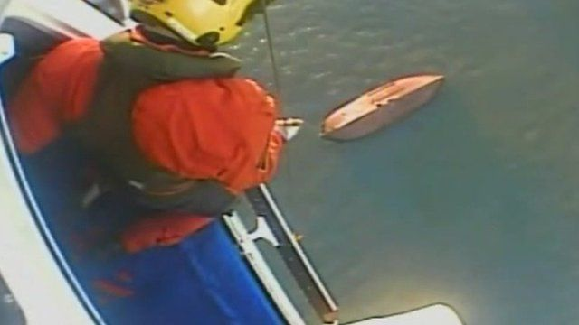 One man was rescued from the upturned hull at 07:30 GMT on Wednesday