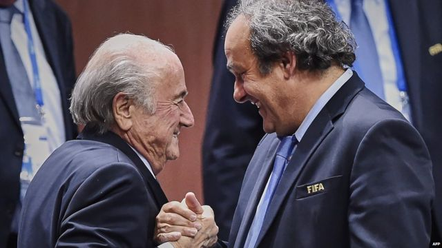 Sepp Blatter shakes hands with Michel Platini