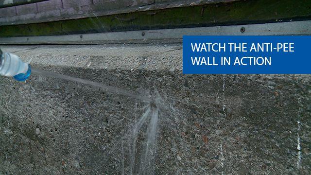 Water splashing against the anti-pee wall